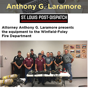 Attorney Anthony G. Laramore presents the equipment to the Winfield-Foley Fire Department